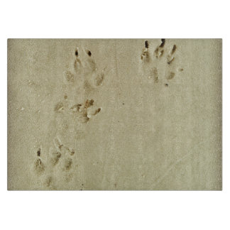 Puppy prints in the sand cutting board