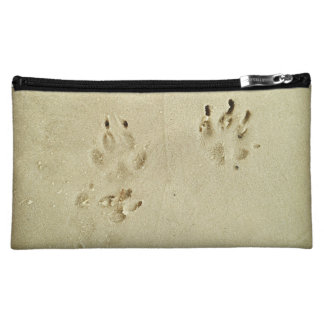 Puppy prints in the sand makeup bag