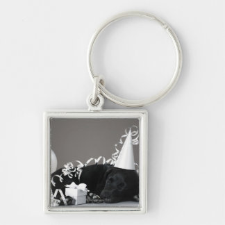 Puppy sleeping in party decorations keychain