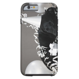 Puppy sleeping in party decorations tough iPhone 6 case