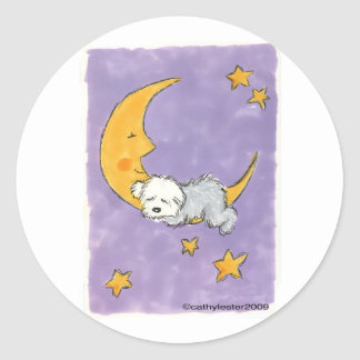 Puppy sleeping on the moon classic round sticker