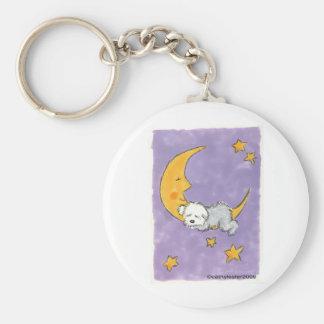 Puppy sleeping on the moon keychain
