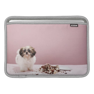 Puppy with cake on floor MacBook air sleeve