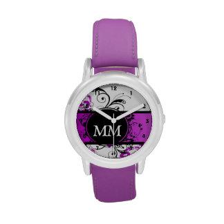 Purple and black monogram on white wrist watches