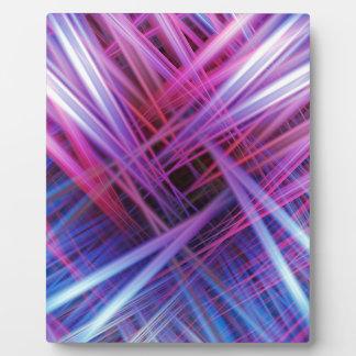 Purple and blue light beams pattern plaque