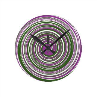 Purple and green pinwheel design clocks