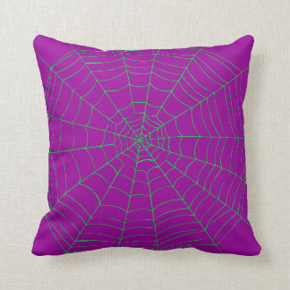 purple and green spider web pillow