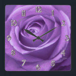 """Purple and Lavender Rose Clock<br><div class=""""desc"""">Purple and Lavender Rose Wall Clock. Part of our at home collections so you can make your favorite place look as cool,  elegant,  classy or wild as you like,  in your favorite color schemes and a style that&#39;s uniquely you.</div>"""