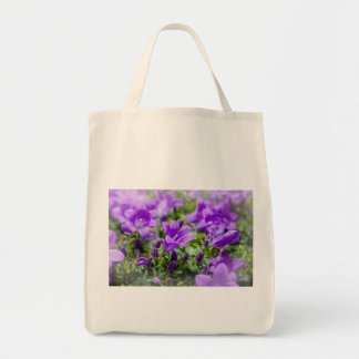 purple blossoms vines plants flora bellflower tote bag