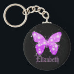 "Purple butterfly and stars personalized with name keychain<br><div class=""desc"">A summery and feminine motive. A butterfly shape filled with shades of purple and shining stars in horizontal stripes.  Black background. Customize and add your name with purple letters.</div>"