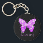 """Purple butterfly and stars personalized with name keychain<br><div class=""""desc"""">A summery and feminine motive. A butterfly shape filled with shades of purple and shining stars in horizontal stripes.  Black background. Customize and add your name with purple letters.</div>"""
