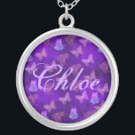 """Purple Butterfly Art Silver Plated Necklace<br><div class=""""desc"""">Purple butterflies and flowers against a blue background textured to resemble an antique rug or tapestry. Great eye-catching and pretty artistic design.</div>"""