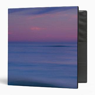 Purple-colored sunrise on ocean shore 2 binder