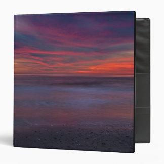 Purple-colored sunrise on ocean shore vinyl binder