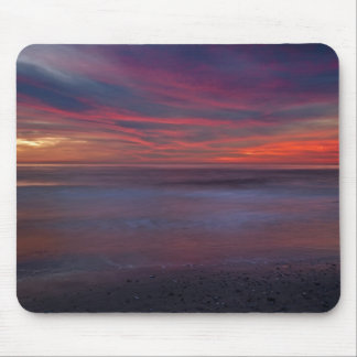 Purple-colored sunrise on ocean shore mouse pad
