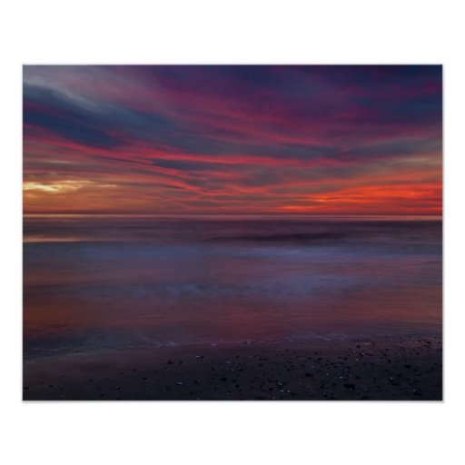 Purple-colored sunrise on ocean shore posters