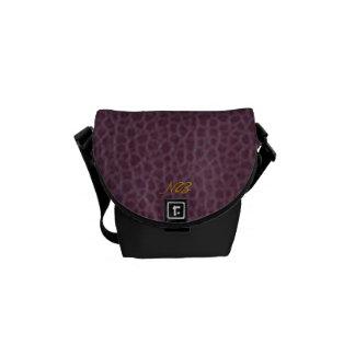 Purple connotes sophistication. courier bag