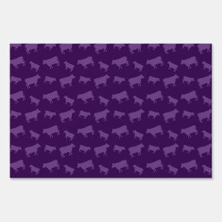 Purple cow pattern sign