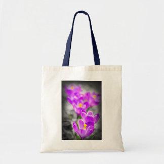 Purple crocus flowers tote bags