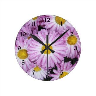Purple daisies with raindrops round clock