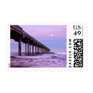 Purple dawn over pier, California Postage