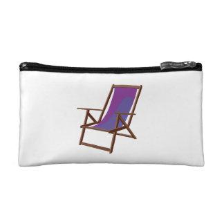 purple fabric beach chair.png cosmetics bags