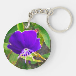 purple flower against green painted effect keychain