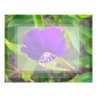 purple flower against green plant design letterhead