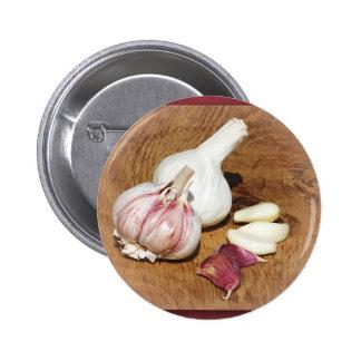 purple garlic on a oak board button
