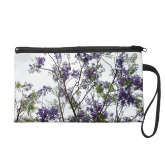 purple green flowers against bright sky floral wristlet purse
