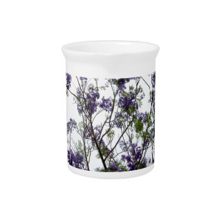 purple green flowers against bright sky floral beverage pitcher