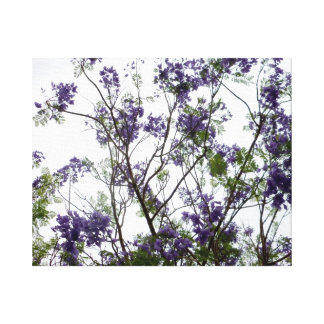 purple green flowers against bright sky floral canvas print