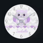 """Purple Grey Owl Nursery Wall Clock<br><div class=""""desc"""">This adorable purple,  lavender and grey owl on grey and white chevron background design will look perfect in your little one&#39;s nursery or bedroom. Perfect for newborns,  babies,  toddlers or child&#39;s bedroom. Other matching products available in my store!</div>"""
