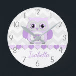 "Purple Grey Owl Nursery Wall Clock<br><div class=""desc"">This adorable purple,  lavender and grey owl on grey and white chevron background design will look perfect in your little one&#39;s nursery or bedroom. Perfect for newborns,  babies,  toddlers or child&#39;s bedroom. Other matching products available in my store!</div>"