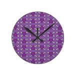 Purple Heart and Crossbones Pattern Round Clocks
