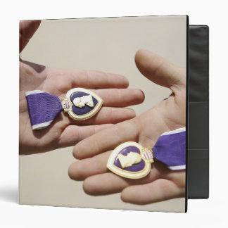 Purple Heart recipients display their medals Binder