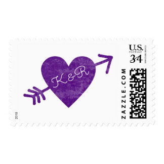 purple heart with an arrow & couple initials postage