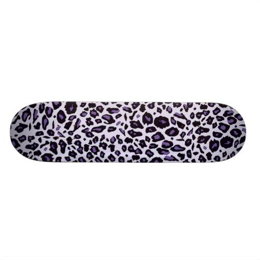 Purple leopard print skate boards