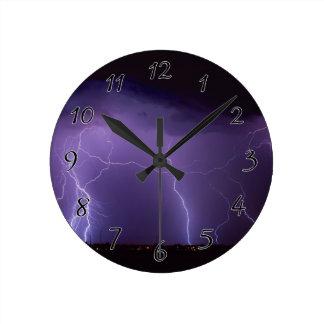 Purple Lightning in a Night Desert Thunder Storm Round Clock