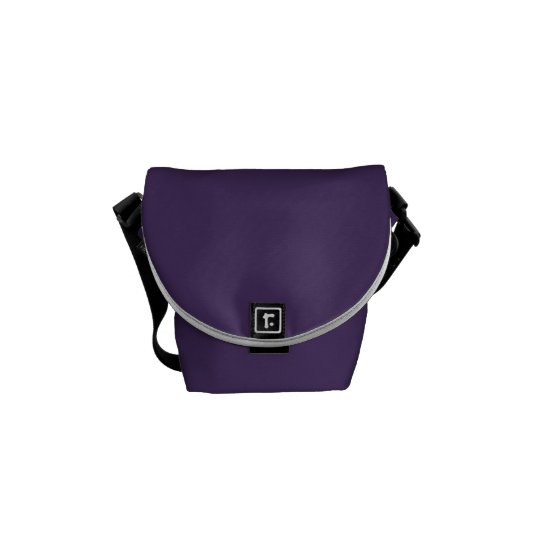 Purple messenger bag with floral print interior