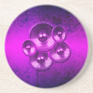 Purple music speakers on a concrete wall sandstone coaster