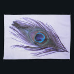 "Purple Peacock Feather on Purple Kitchen Towel<br><div class=""desc"">A peacock feather with the purple tones brought out on a light purple background.</div>"