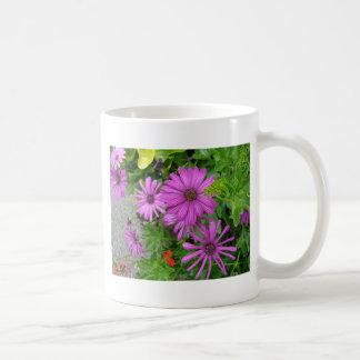 Purple petals amongst the greenery coffee mugs