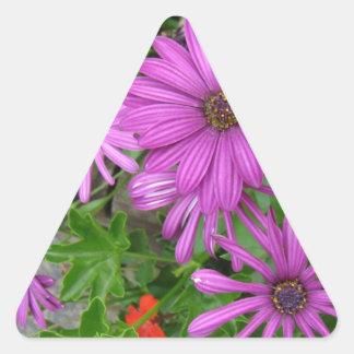 Purple petals amongst the greenery triangle sticker