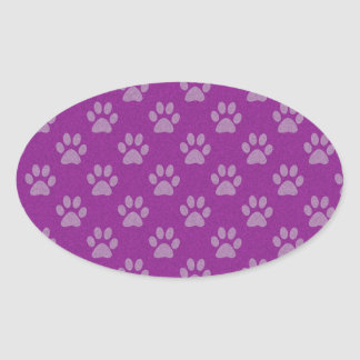 Purple puppy paws pattern oval sticker