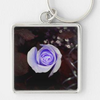 purple rose colorized flower against dark backgrou keychain