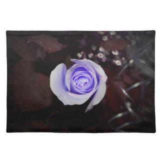 purple rose colorized flower against dark backgrou placemat