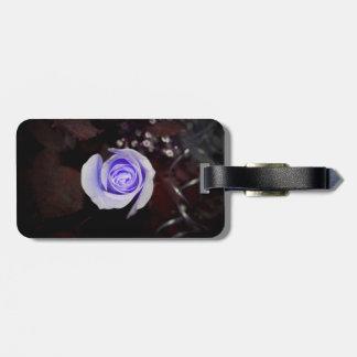 purple rose colorized flower against dark backgrou travel bag tag