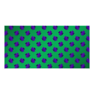 Purple shamrocks on green background photo card template