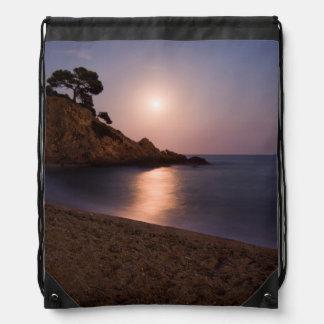 Purple Sunset beach Catalonia, Spain Drawstring Backpacks